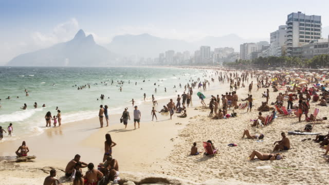 tl, ws crowds on ipanema beach / rio de janeiro, brazil - brazil stock videos & royalty-free footage