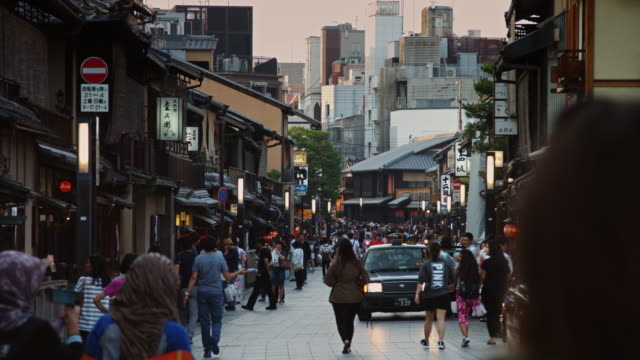 crowds on kyoto street - gion stock videos and b-roll footage