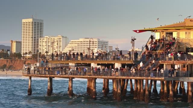 crowds on santa monica pier - aerial - santa monica stock videos & royalty-free footage