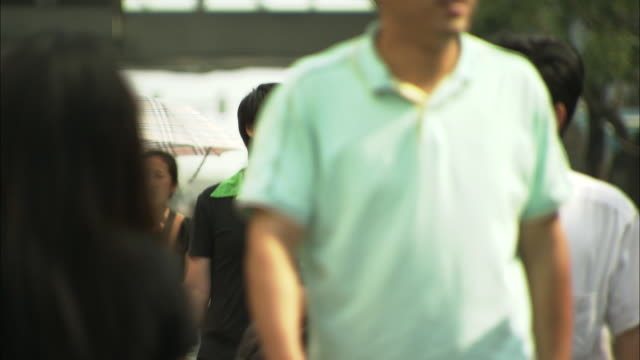 ms tu selective focus crowds on sidewalk in xidan shopping district, beijing, china - pavement video stock e b–roll