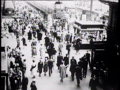 Crowds on station concourse London 1957