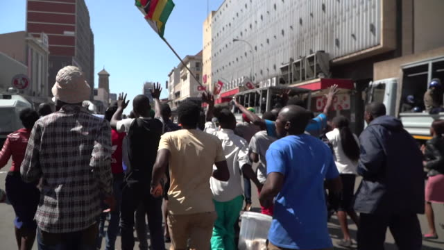 crowds on the streets in harare waiting for the presidential election results - zimbabwe stock videos & royalty-free footage