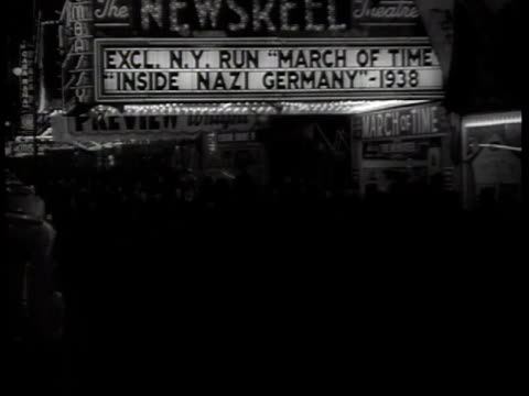 crowds outside embassy theater with march of time inside nazi germany 1938 on marquee / new york city, new york, usa - 1938 stock videos & royalty-free footage