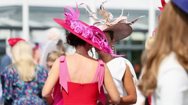 crowds show off their various outfits and hats as they arrive for ladies' day at the 2019 summer festival at galway racecourse. thursday marks day... - horse racing stock videos & royalty-free footage