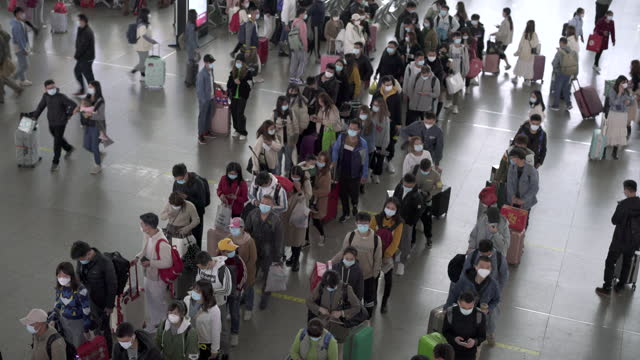 crowds shuttle inside stations in china's first-tier cities - pedestrian video stock e b–roll