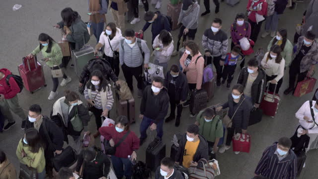 crowds shuttle inside stations in china's first-tier cities - citizenship stock videos & royalty-free footage