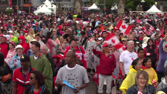 Crowds singing Leonard Cohen's 'Hallelujah' during Canada's 150th birthday celebrations in Ottawa