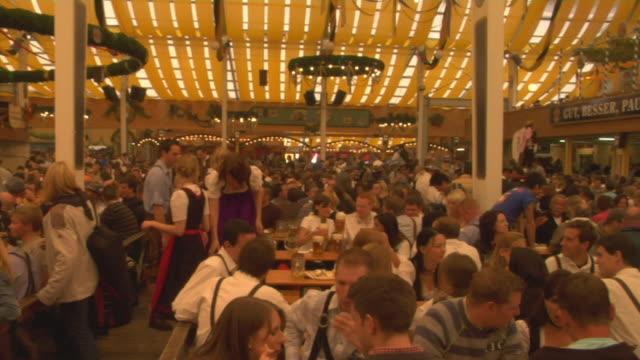 WS PAN Crowds sitting in Oktoberfest beer hall, Oktoberfest, Munich, Germany