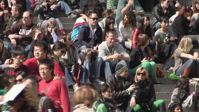 ms pan crowds sitting on steps of metropolitan museum of art / new york, united states - metropolitan museum of art new york city stock videos & royalty-free footage