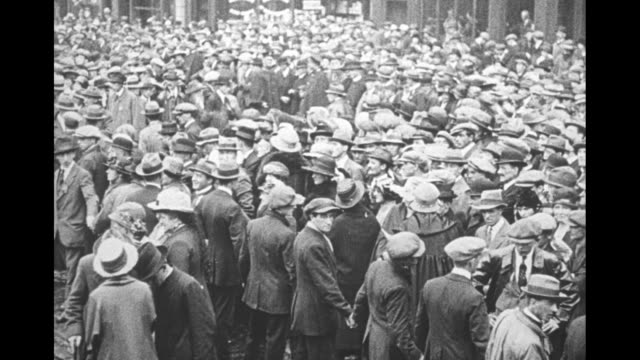crowds stand outside mansion house as sinn fein dignitaries arrive to opening session of the revolutionary dail / count george noble plunkett... - sinn fein stock videos & royalty-free footage