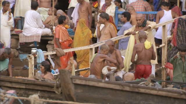 ws pan crowds standing on shore of ganga river / varanasi, uttar pradesh, india - semi dress stock videos and b-roll footage