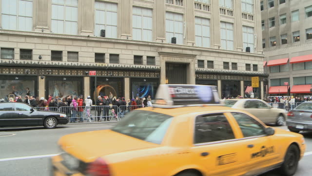 WS Crowds standing outside Saks 5th Avenue store / New York City, New York, USA