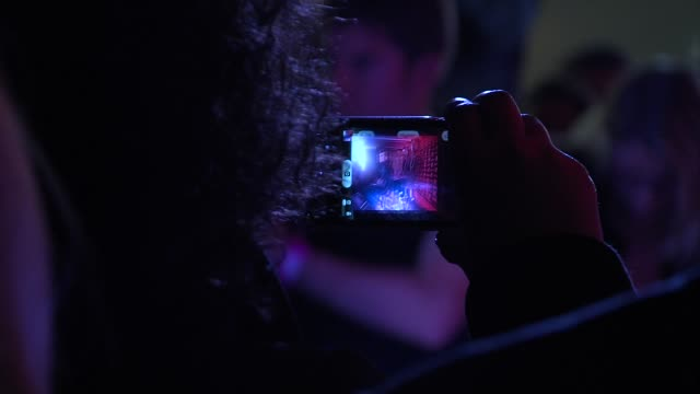 crowds taking pictures of the finalists at x factor secret gig at talk talk store, soho on november 29, 2012 in london, england. - リアリティー番組点の映像素材/bロール