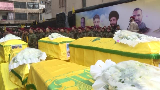 crowds throng the streets of beirut's southern suburbs during a funeral procession for five hezbollah fighters killed in battle in syria's idlib... - lebanon country stock videos & royalty-free footage