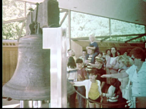 1976 montage crowds viewing and touching liberty bell / philadelphia, pennsylvania, usa - liberty bell stock videos & royalty-free footage