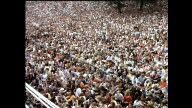 vídeos de stock e filmes b-roll de crowds wait for the rolling stones in hyde park; 1969 - 1969