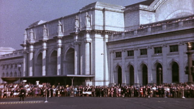 Crowds waiting outside Union Station flags at half mast for the train bearing President Roosevelt's body / Washington DC United States