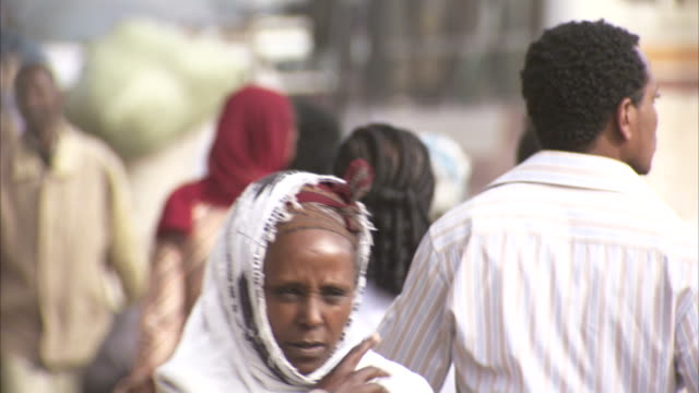 crowds walk along a busy street in addis ababa. available in hd. - ethiopia stock videos & royalty-free footage