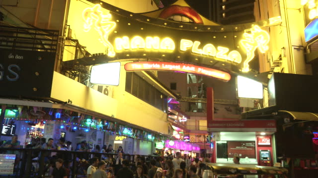 crowds walk into nana plaza in the nana section of bangkok on the day the government relaxed mourning restrictions the king of thailand died october... - nutten stock-videos und b-roll-filmmaterial