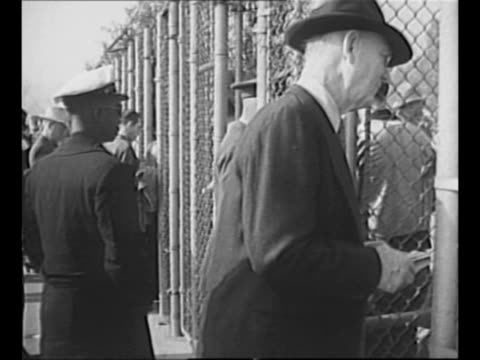 crowds walk on grounds of rose bowl stadium as they arrive for 1946 rose bowl football game / gates of stadium with fans entering and police standing... - crimson tide stock videos & royalty-free footage