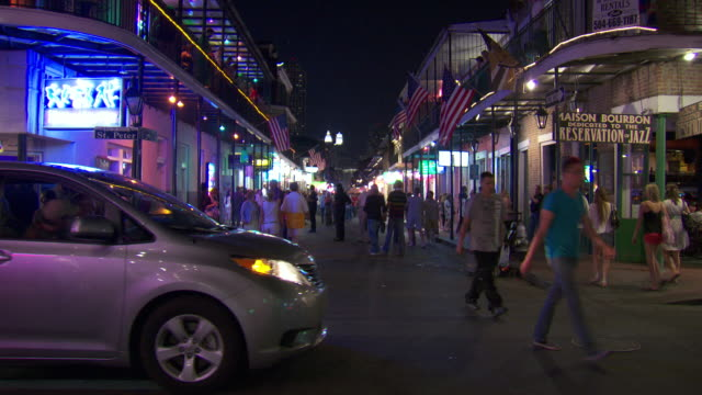 ms crowds walking on bourbon street at night / new orleans, louisiana, united states - bourbon street new orleans stock videos and b-roll footage