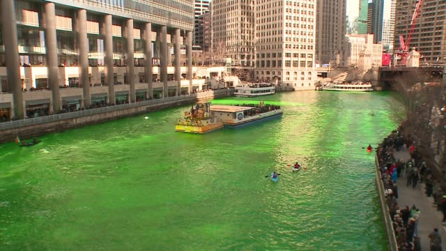 wgn crowds watch as chicago river dyed green for st patrick's day on march 11 2017 - river green stock videos & royalty-free footage