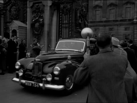 Crowds wave as Sir Anthony Eden leaves Buckingham Palace after accepting the position of Prime Minister