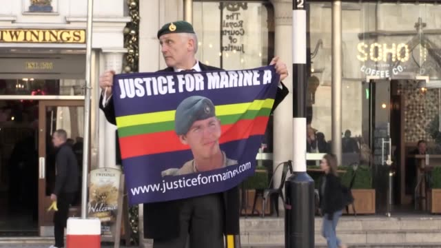 crowds with flags gather as an appeal hearing saw the marine's murder conviction quashed and replaced with manslaughter. - 代理点の映像素材/bロール