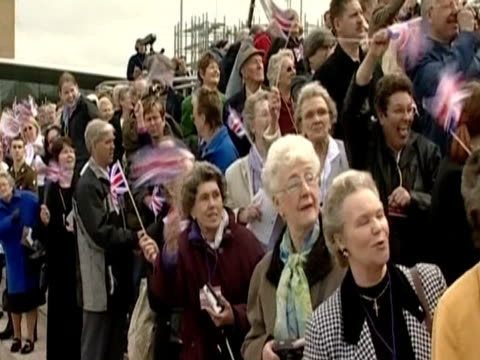 crowds with little flags cheer the queen as she arrived to open the gateshead millennium bridge as part of her golden jubilee royal tour - golden jubilee stock videos & royalty-free footage