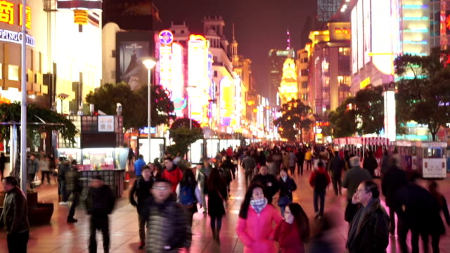 crowds,walking street and commercial buildings exterior in shanghai,time lapse.