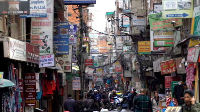 crowdy shopping street in thamel district of kathmandu, nepal - nepal stock videos & royalty-free footage