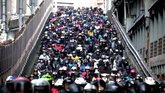 crowed of people are riding scooters, traffic on the bridge through city - pechino video stock e b–roll