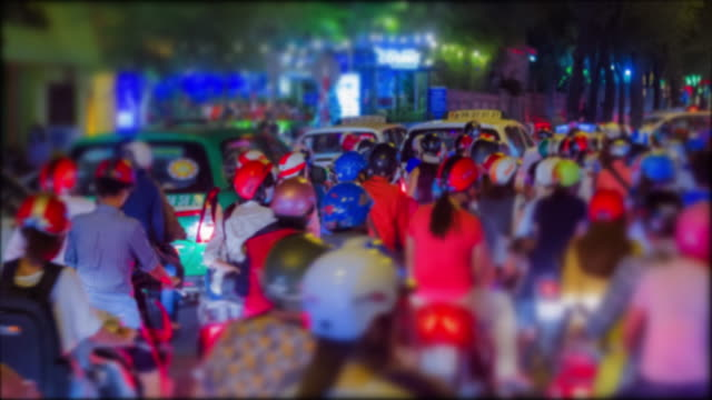 4k time lapse (4096x2160) :crowed scene of city traffic in rush hour, crowd of people wear helmet, transport by motorcycle in vietnam,zoom out.(apple prores 422(hq)). - ho chi minh city stock videos & royalty-free footage