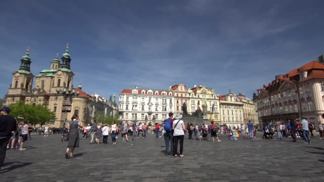 crowed tourists wolking in prague old town square at sunny day - stare mesto stock videos and b-roll footage