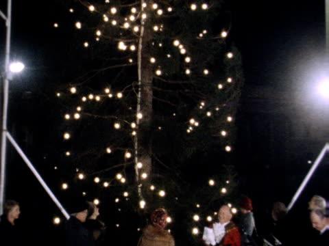 stockvideo's en b-roll-footage met crown princess sonja of norway turns on the christmas tree lights at trafalgar square - kleding