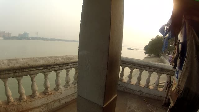 crows fly off a balcony near the hooghly river in india. - hooghly river stock videos & royalty-free footage