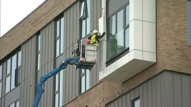 croydon cityscape residents hit with 2 million pound bill to replace 'grenfell' cladding r260617005 / cladding removed from tower block by two... - removing stock videos & royalty-free footage