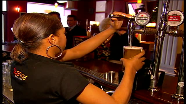 croydon council launch safety campaign aimed at young women and their personal safety top shot bar pan back view barmaid pulling pint of lager back... - spiked stock videos & royalty-free footage