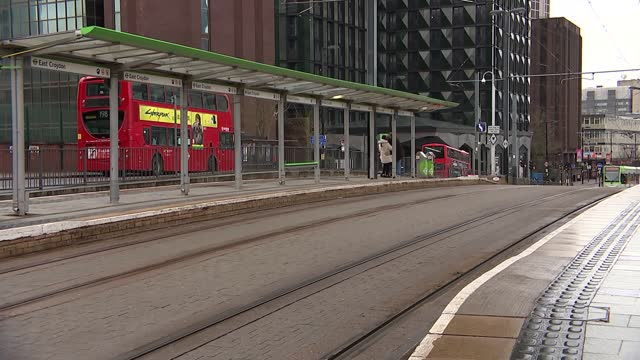 croydon general views; england: london: croydon: ext east croydon station / various of trams along and people along on high streets in town centre,... - croydon england stock videos & royalty-free footage