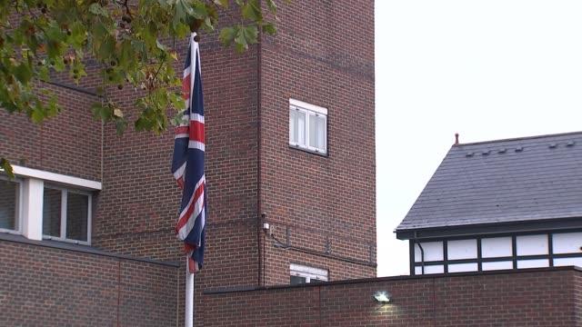 croydon police station gvs; england: london: croydon: ext sign and crest / police lamp / union jack flag on flagpole / entrance / police vans parked... - ロンドン クロイドン点の映像素材/bロール