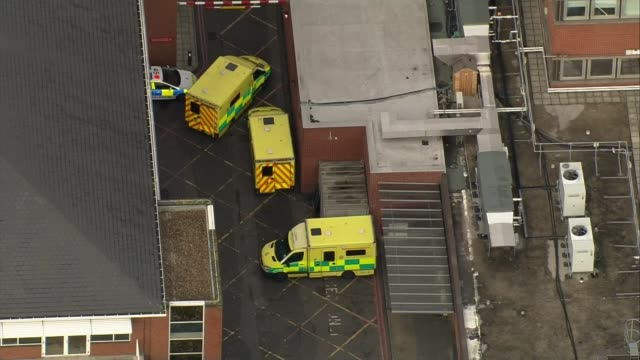 first victim named london ambulances outside unidentified hospital tooting air view helipad on roof of st george's hospital - helicopter landing pads stock videos and b-roll footage