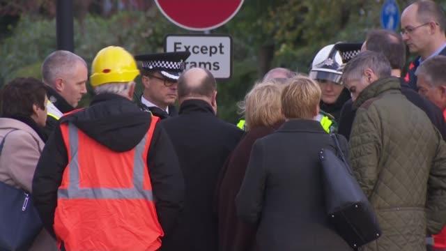 Sadiq Khan visits scene ENGLAND London Croydon EXT Sadiq Khan and Gavin Barwell MP along with others / Khan and Barwell meeting emergency services...