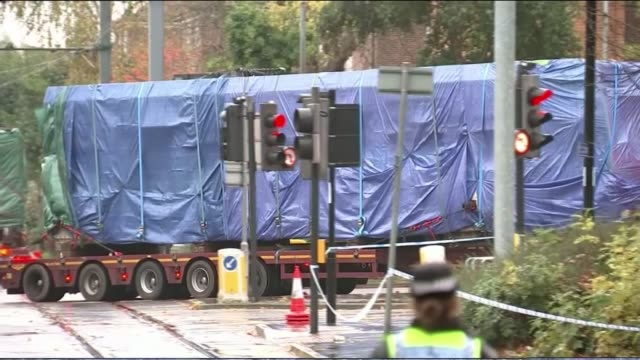 Three remaining victims named as carriages removed for examination Lorry along with covered tram carriages on flat loader 'Sandilands Tramlink' sign...