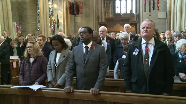tram driver named england london croydon croydon minster int various shots congregation standing during remembrance day service as 'the last post'... - remembrance day stock videos and b-roll footage