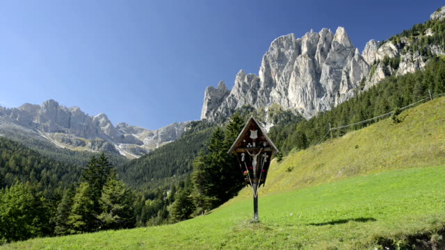crucifix at rosengarten mountain group - val di fassa stock videos and b-roll footage