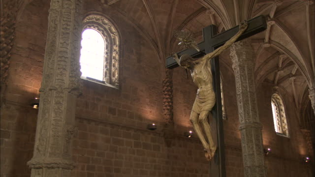 A crucifix statue inside Jeronimos Monastery in Lisbon, Portugal