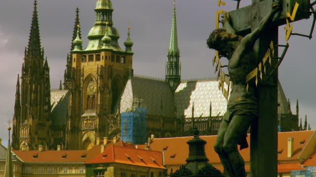 ms crucifix with st vitus cathedral behind / prague, czech republic - hradcany castle stock videos and b-roll footage