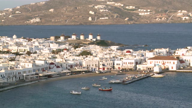 WS PAN Cruise and ship bobbing in water / Myconos, Cylades Islands, Greece