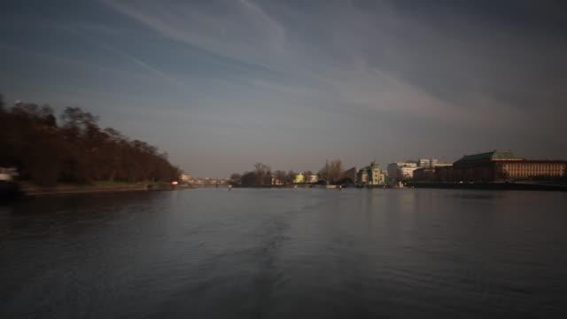 cruise boat returns to mooring, vltava river, prague - river vltava stock videos & royalty-free footage