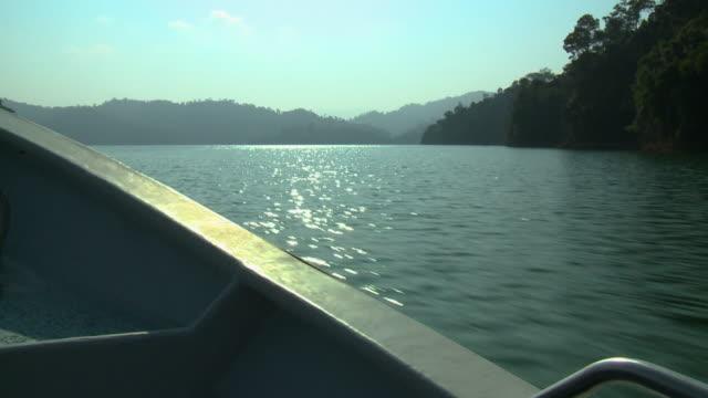 cruise boat sun reflection, temenggor lake, gerik - push in stock videos & royalty-free footage
